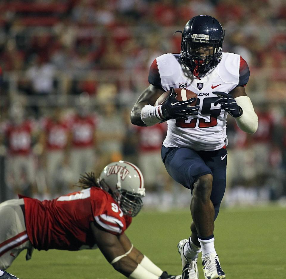 Arizona routs UNLV in Carey's return, 58-13