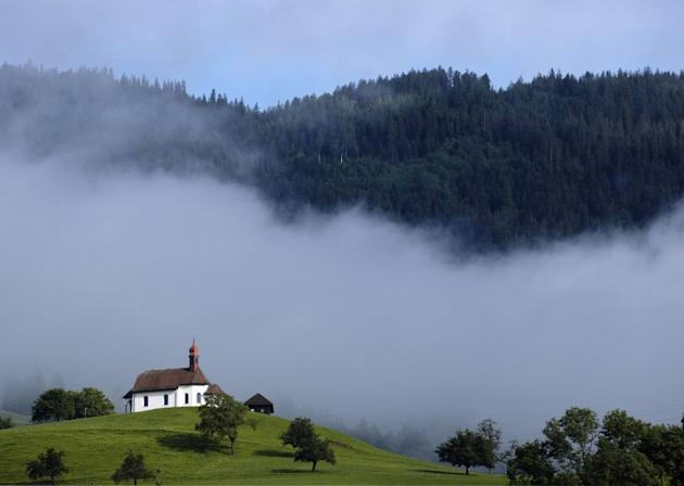 A church is pictured in the early morning on a mountain in Sarnen, central Switzerland.