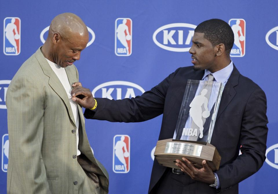Cleveland Cavaliers' Kyrie Irving, right, jokes with head coach Byron Scott after Irving was presented with the NBA Rookie of the Year Award at the basketball team's headquarters in Independence, Ohio Tuesday, May 15, 2012. (AP Photo/Mark Duncan)