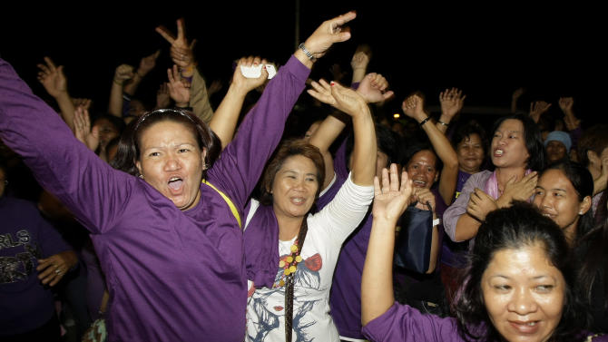 Filipino women celebrate as Philippine legislators pass a landmark law that would provide government funding for contraceptives and sexuality classes at the Philippine Congress in suburban Quezon City, north of Manila, Philippines on Monday, Dec. 17, 2012. Philippine legislators passed the law despite strong opposition by the dominant Roman Catholic Church and its followers, some of whom threatened to ask the Supreme Court to thrash the legislation. (AP Photo/Aaron Favila)