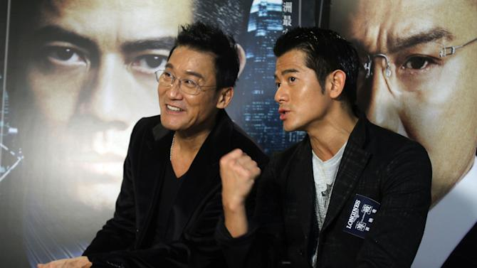 "In this photo taken on Monday, Nov. 12, 2012, Hong Kong actors Aaron Kwok,  right, and Tony Leung Ka Fai speak during an interview for their new film ""Cold War"" in Taipei, Taiwan. (AP Photo/Chiang Ying-ying)"
