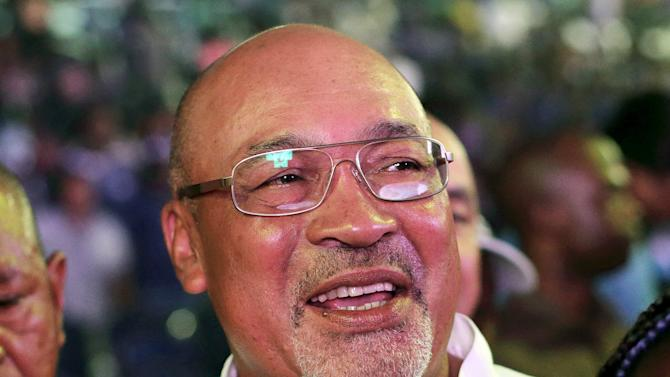 Suriname's President Desi Bouterse celebrates his party's victory in the parliamentary elections in Paramaribo