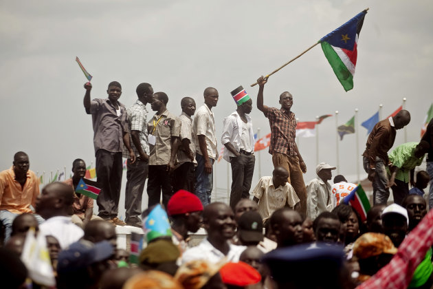 Southern Sudanese celebrate their first independence day in the capital city of Juba on Saturday, July 9, 2011. The southern Sudanese opted for secession during a popular referendum in January 2011. Saturday's declaration and recognition makes the Republic of South Sudan the world's 193rd country. (AP Photo/Pete Muller)