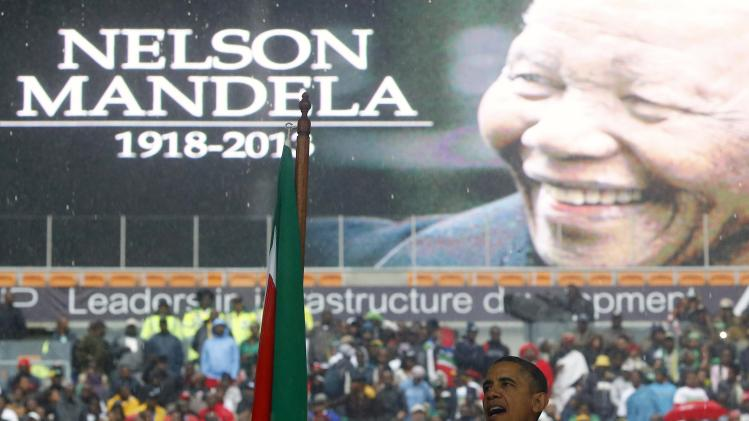 U.S. President Obama delivers his speech during memorial service for Nelson Mandela in Johannesburg