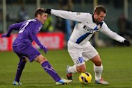 "Antonio Cassano (right) dribbles past Fiorentina's Gonzalo Javier Rodríguez at a game in Florence last month. The Inter Milan striker has named his newborn son after ""the greatest player of all time"", namely Lionel Messi in his view"