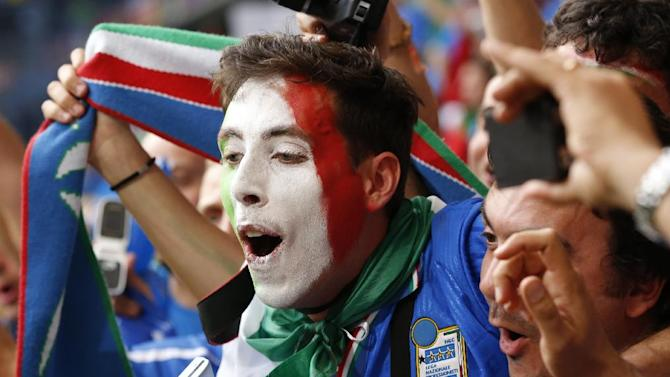 An Italy fan cheers prior to the Euro 2012 soccer championship Group C match between Italy and the Republic of Ireland in Poznan, Poland, Monday, June 18, 2012. (AP Photo/Gregorio Borgia)