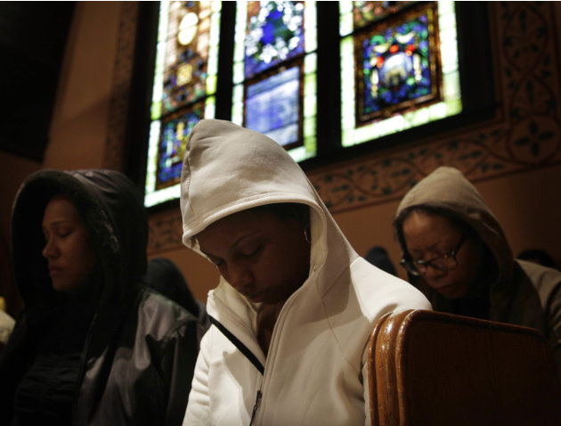 Congregants bow their heads in prayer during a service at Middle Collegiate Church in New York, Sunday, March 25, 2012. Church-goers were invited to wear hoodies to services to show their support for 