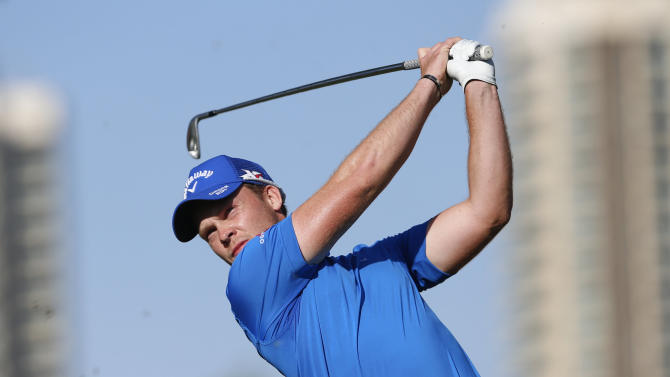 Willett of England tees off on the 15th hole during the Dubai Desert Classic golf championship