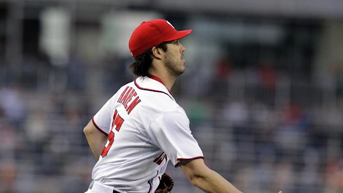 Washington Nationals starting pitcher Dan Haren (15) tosses the ball to first for the out on St. Louis Cardinals' Allen Craig during the first inning of a baseball game at Nationals Park, Monday, April 22, 2013, in Washington. (AP Photo/Alex Brandon)