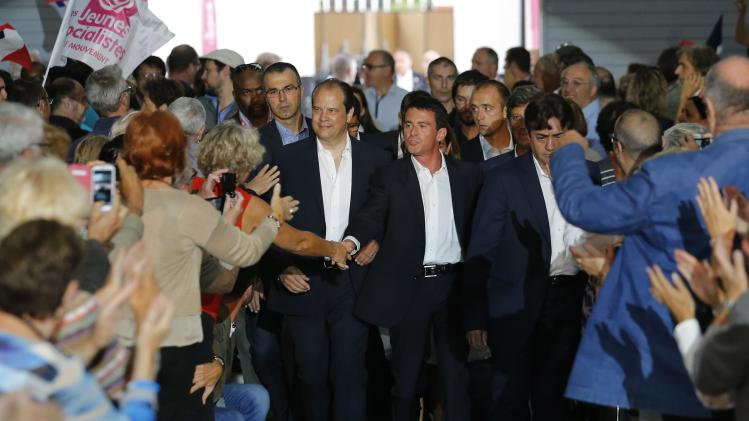"""French Prime Minister Valls and French Socialist Party head Cambadelis, attend the Socialist Party's """"Universite d'ete"""" summer meeting in La Rochelle"""
