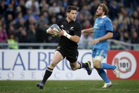 New Zealand All Blacks' Cory Jane scores a try against Italy during their test rugby union match at the Olympic stadium in Rome
