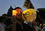 "A protester holding a fan displaying the words ""No Nukes"" shouts slogans as he takes part in a rally on July 29 outside Japan's parliament to demonstrate against the use of nuclear power"