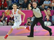 France&#39;s Celine Dumerc during the women&#39;s basketball quarter-final against the Czech Republic at the London Olympics on August 7. France advanced to the semi-finals of the Olympic women&#39;s basketball tournament by defeating the Czechs 71-68