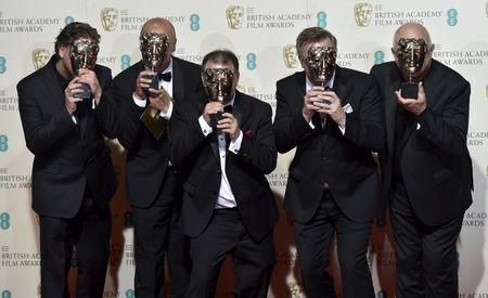 The sound engineers of The Revenant pose after winning their awards for best sound at the British Academy of Film and Television Arts (BAFTA) Awards at the Royal Opera House in London
