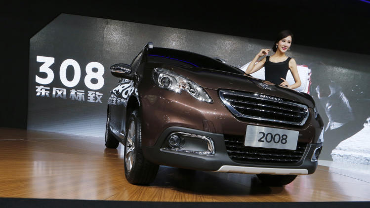 China's Dongfeng, French state invest in Peugeot