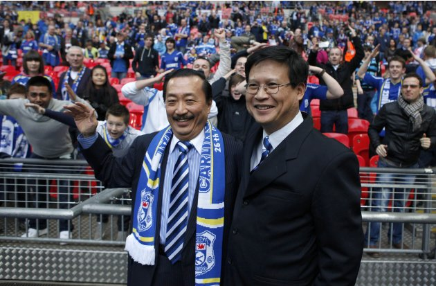 File photo of Cardiff City's Malaysian Chairman Chan Tien Ghee and Malaysian owner Vincent Tan smiling ahead of their English League Cup final soccer match against Liverpool at Wembley Stadium in Lond