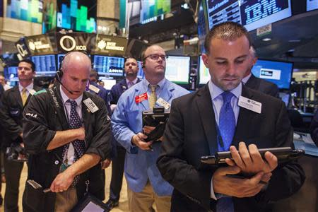 Traders pause during a moment of silence to honor victims of the 9/11 attacks on the World Trade Center, on the floor of the New York Stock Exchange