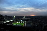 A view taken on February 2, 2013 of the Kasimpasa Stadium in Istanbul as the sun sets over the Goldenhorn. Seven giant Turkish companies have pledged to chip in for the national bid to host the 2020 Olympics, Sports Minister Suat Kilic said