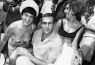 &#39;Bond&#39; star Sean Connery poses with two women in Cannes in 1965. A series of events are to be held around the world on October 5 to mark the 50th anniversary of the Bond films, the iconic spy saga that helped define half-a-century of cultural, political and technological upheaval