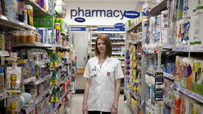 Walgreen's pharmacy manager Sarah Freedman stands in her store in Washington, Tuesday, June 26, 2012.  Would you go to a pharmacy to get tested for the AIDS virus? Health officials want to know. The Centers for Disease Control and Prevention on Tuesday announced a $1.2 million pilot project to offer free rapid HIV tests at pharmacies and clinics in 24 cities and rural communities.  (AP Photo/Evan Vucci)