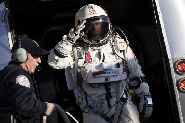 FILE - In this Thursday, March 15, 2012 file photo provided by Red Bull Stratos, Felix Baumgartner salutes as he prepares to board a capsule carried by a balloon during the first manned test flight for Red Bull Stratos in Roswell, N.M. On Monday, Oct. 8, 2012 over New Mexico, Baumgartner will attempt to jump higher and faster in a free fall than anyone ever before and become the first skydiver to break the sound barrier. (AP Photo/Red Bull Stratos, Joerg Mitter)