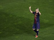 Barcelona's Lionel Messi celebrates after scoring during their Spanish La Liga match against Rayo Vallecano at the Teresa Rivero stadium in Madrid. Messi smashed through the 300-goal mark with a brace as Barca won 5-0, to go three points clear at the top of the ligue