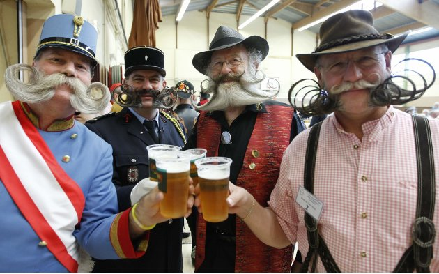 Participants have a beer as they take part in the 2012 European Beard and Moustache Championships in Wittersdorf near Mulhouse