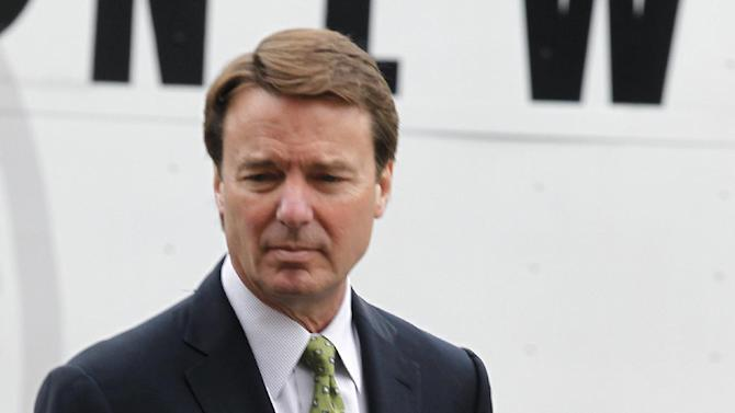 John Edwards makes his way to a federal courthouse where he is standing trial for campaign corruption in Greensboro, N.C., Tuesday, May 15, 2012. (AP Photo/Bob Leverone)