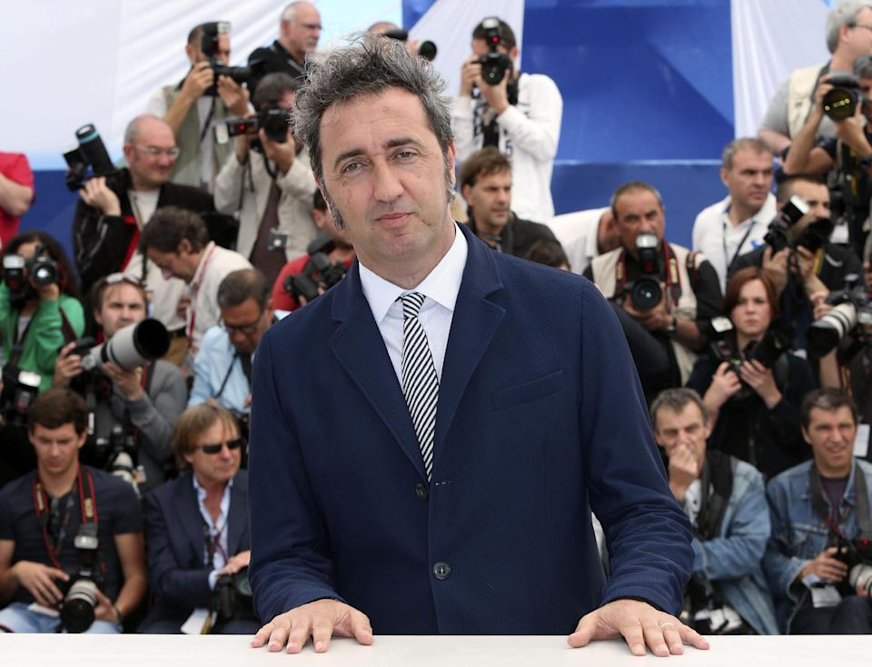 Director Paolo Sorrentino poses for photographs during a photo call for the film The Great Beauty at the 66th international film festival, in Cannes, southern France, Tuesday, May 21, 2013. (Photo by Joel Ryan/Invision/AP)