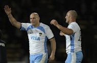 Pumas' centre Felipe Contepomi (L) and lock Rodrigo Bruno celebrate after defeating France in their rugby union Test match at Mario Kempes stadium in Cordoba, on June 16. Argentina won 23-20