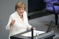 <p>German Chancellor Angela Merkel addresses German lawmakers before they voted on the EU fiscal pact and permanent ESM bailout fund. German lawmakers approved two euro-crisis fighting tools by a two-thirds majority Friday rallying to a call by Merkel to show the world Germany's commitment to the single currency.</p>