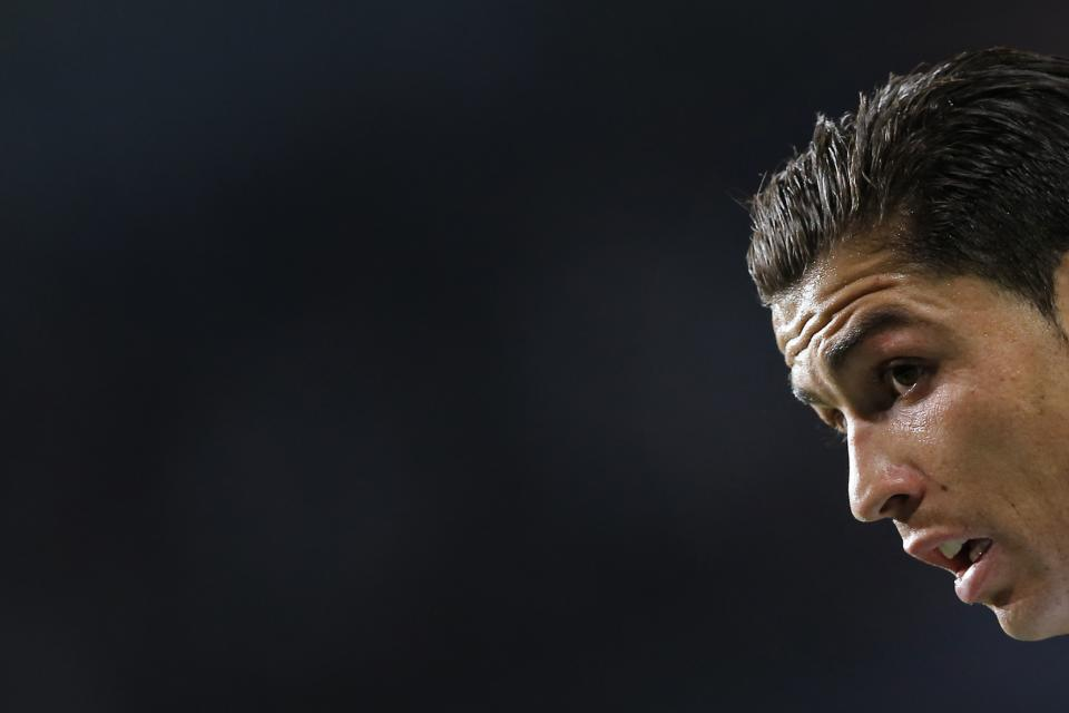 Real Madrid's Cristiano Ronaldo from Portugal reacts  during a Champions League round of 16 first leg soccer match against Manchester United at the Santiago Bernabeu stadium in Madrid, Wednesday Feb. 13, 2013. (AP Photo/Daniel Ochoa de Olza)