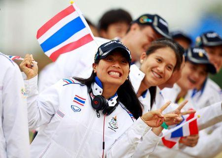 Thai princess Sirivannavari Nariratana poses with the Thai Equestrian team during the opening ceremony of the Equestrian competition at  27th SEA Games in Naypyitaw