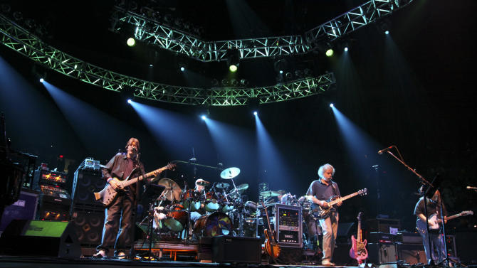FILE - This May 9, 2009 file photo shows Phil Lesh, left on bass, with Bob Weir, center and Warren Haynes, right, performing with their band The Dead, formerly the Grateful Dead at the Forum in the Inglewood section of Los Angeles, Calif. Weir fell onstage while strumming his guitar at a concert in Port Chester, N.Y. In a video posted online, the 65-year-old musician collapsed Thursday during a performance with his Furthur bandmates at The Capitol Theatre. He was quickly helped off the floor as the crowd cheered him on. Weir is currently on a tour with Furthur, the band he formed with fellow Grateful Dead bandmate Phil Lesh. Lesh told the crowd Thursday that Weir had been suffering from a strained shoulder. (AP Photo/Richard Vogel, file)