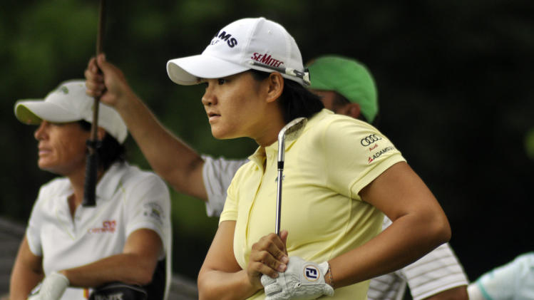 Yani Tseng,of Taiwan, watches her shot on the 15th hole during the second round of the Wegmans LPGA Championship golf tournament in Pittsford, N.Y., Friday, June 24, 2011. (AP Photo/Heather Ainsworth)