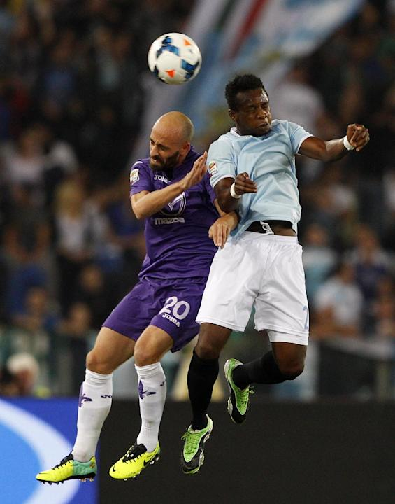 Fiorentina midfielder Borja Valero, of Spain, left, and Lazio midfielder Ogenyi Onazi, of Nigeria, jump for the ball during a Serie A soccer match between Lazio and Fiorentina, at Rome's Olympic stadi