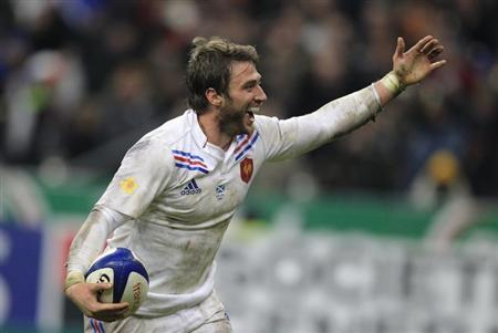 France's Maxime Medard reacts after scoring a try during their Six Nations rugby union match against Scotland at the Stade de France in Saint-Denis