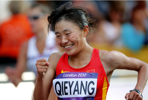 China's Qieyang Shenjie celebrates her third place finish in the women's 20-kilometer race walk at the 2012 Summer Olympics, Saturday, Aug. 11, 2012, in London.  (AP Photo/Emilio Morenatti)