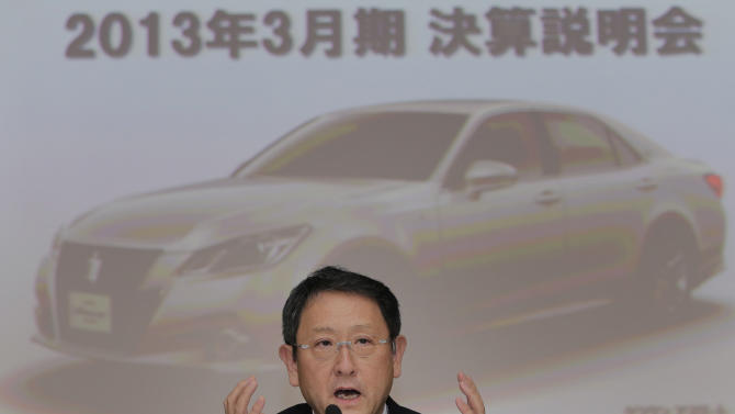 """Toyota Motor Corp. President Akio Toyoda speaks during a news conference at the automaker's headquarters in Tokyo, Wednesday, May 8, 2013. Toyota's January-March profit more than doubled to 313.9 billion yen (Canadian) $3.2 billion) as cost cuts and better sales worked with a weakening yen to add momentum to the automaker's comeback. The screen in the background reads: """"The announcement of the annual earnings result for March 2013."""" (AP Photo/Itsuo Inouye)"""