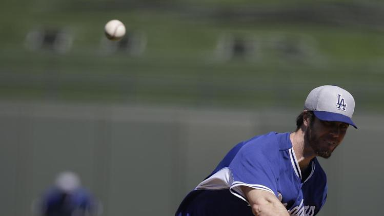 Los Angeles Dodgers starting pitcher Dan Haren throws during a spring exhibition baseball game against the Kansas City Royals Tuesday, March 11, 2014, in Surprise, Ariz. (AP Photo/Darron Cummings)