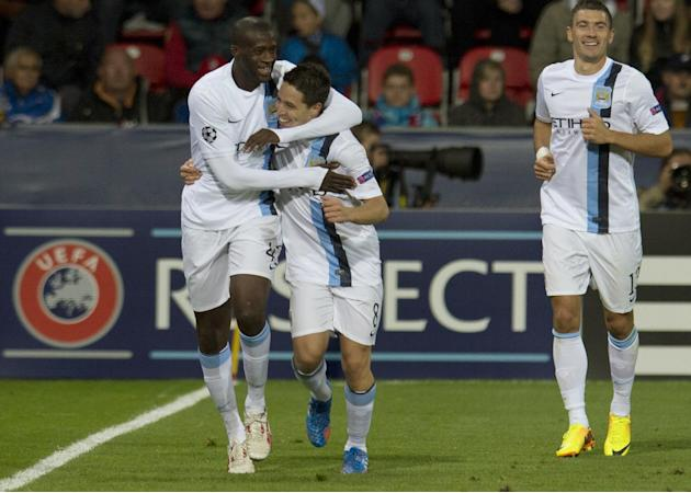 Manchester City's players, Yaya Toure, left, and Samir Nasri, second left, celebrate their second goal, during the Champion's League Group D soccer match against Viktoria Plzen , in Plzen, Czech Repub