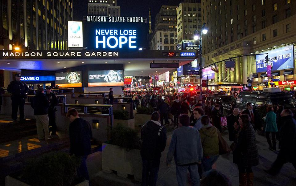 "People gather before the ""12-12-12"" benefit concert at Madison Square Garden in New York Wednesday, Dec. 12, 2012. Music royalty from the Rolling Stones to Kanye West are gathering at Madison Square Garden Wednesday for a benefit concert to help storm victims. (AP Photo/Craig Ruttle)"