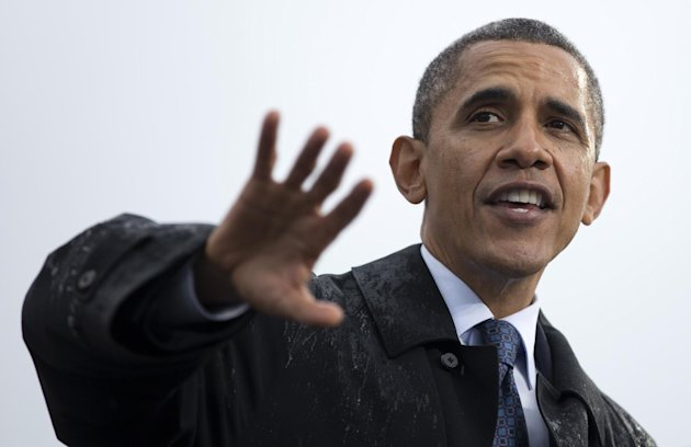 President Barack Obama speaks at a campaign event at rainy Cleveland State University, Friday, Oct. 5, 2012, in Cleveland. (AP Photo/Carolyn Kaster)