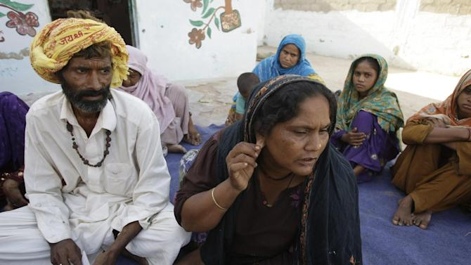 In this Oct. 4, 2012 photo, Hindu woman Pathani shows that attackers ripped her gold earrings at a local temple in Karachi, Pakistan. An attack on the Hindu temple on the outskirts of Pakistan's largest city took place in late September on the Day of Love for the Prophet_and residents fear it will not be the last attack. It was the latest in a rising tide of violence and discrimination against Hindus in the 95 percent Muslim country, where Islamic extremism is growing. (AP Photo/Fareed Khan)