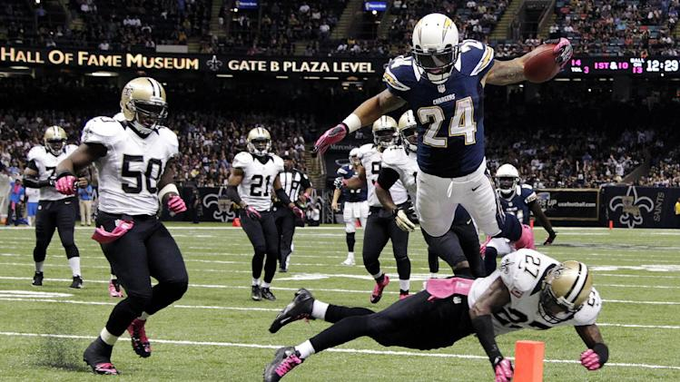San Diego Chargers running back Ryan Mathews (24) dives to the goal line for a touchdown over New Orleans Saints free safety Malcolm Jenkins (27) in the second half of an NFL football game at Mercedes-Benz Superdome in New Orleans, Sunday, Oct. 7, 2012. (AP Photo/Dave Martin)
