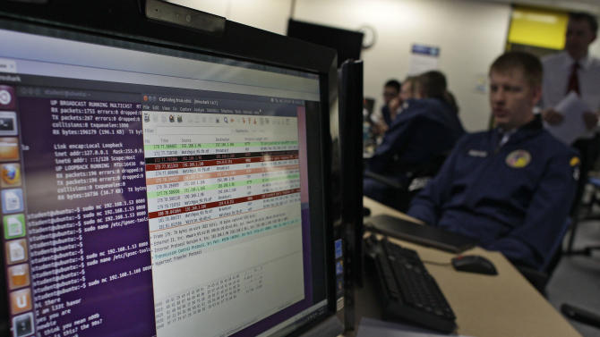 In this Feb. 20, 2013 photo, a cadet works at a computer inside a classroom at the Center for Cyberspace Research, where cyber warfare is taught, at the U.S. Air Force Academy, in Colorado Springs, Colo. The U.S. service academies are ramping up efforts to groom a new breed of cyberspace warriors to confront increasing threats to the nation's military and civilian computer networks that control everything from electrical power grids to the banking system. (AP Photo/Brennan Linsley)