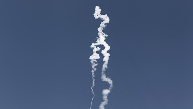 IA smoke trail of a missile test-fired by the Israeli army as seen from the central Israeli town of Yavne, Wednesday, Nov. 2, 2011. Israel  successfully test-fired a missile capable of carrying a nuclear warhead and striking Iran, fanning the public debate over reports the country's top leaders are agitating for a military attack on Tehran's atomic facilities. (AP Photo/Ilan Assayag) ISRAEL OUT
