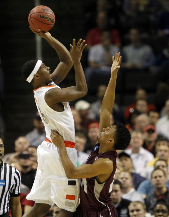 Syracuse's C.J. Fair shoots over Montana's Spencer Coleman during their NCAA basketball tournament second round game in San Jose