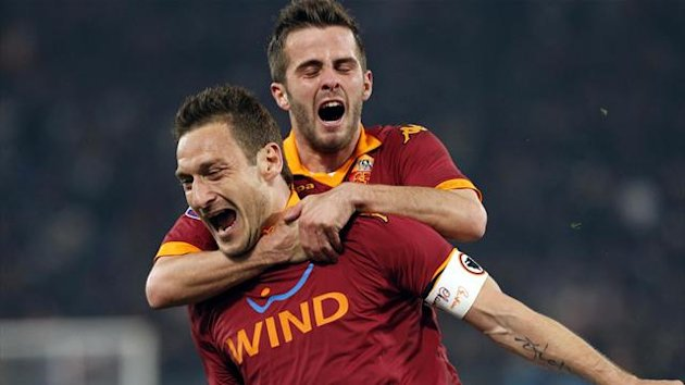 Francesco Totti celebrates scoring against Juventus with Roma team-mate Miralem Pjanic