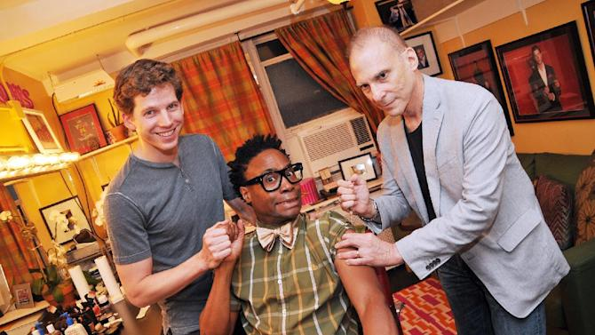 "This Oct. 7, 2012 photo provided by The O and M Company shows actor Stark Sands, Left, holding hands with Billy Porter, center, both of ""Kinky Boots,"" as Dr. Barry Kohn administers the flu shot in New York. (AP Photo/The O and M Company, Jenny Anderson)"